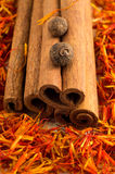 Cinnamone, peppercorn and saffron close-up Royalty Free Stock Photography
