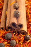 Cinnamone, peppercorn and saffron close-up Royalty Free Stock Image