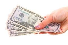 Cinqüênta cédulas do dólar na mão fêmea foto de stock royalty free