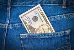 Cinqüênta dólares de conta que cola fora do bolso das calças de brim Fotografia de Stock Royalty Free