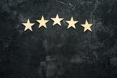 Cinq étoiles en bois Photos stock
