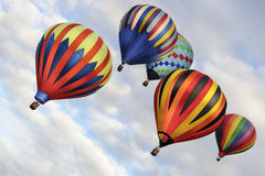 Cinq ballons en vol Photographie stock libre de droits