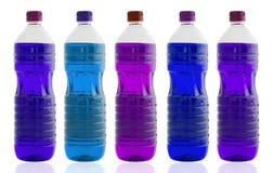 Cinq bouteilles de pétrole Photographie stock
