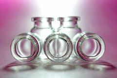 Cinq bouteilles en verre Image stock
