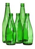 Cinq bouteilles en verre vertes d'isolement sur le blanc Photos libres de droits