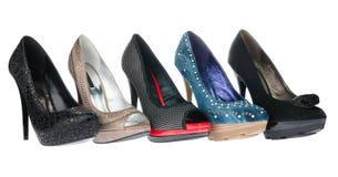 Cinq chaussures de paires des talons hauts Photographie stock libre de droits