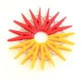 Cinq chevilles rouges et cinq jaunes situées autour Photos stock
