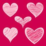 Cinq coeurs rouges Images stock