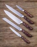 Cinq couteaux de cuisine Photographie stock libre de droits