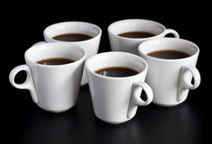 Cinq cuvettes de café Photographie stock