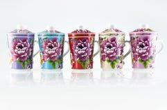 Cinq cuvettes de thé de porcelaine Image libre de droits