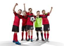 Cinq footballeurs adolescents célébrant la victoire sur le blanc Photographie stock