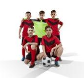 Cinq footballeurs adolescents sur le blanc Images libres de droits