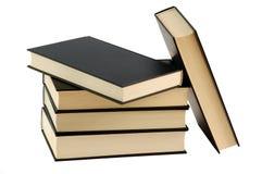 Cinq ont fermé les livres noirs Images stock