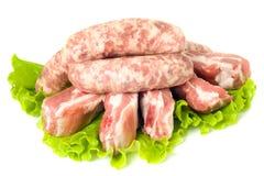 Cinq parties de viande et de saucisses de porc photographie stock