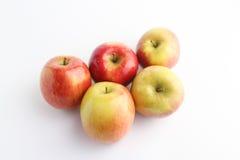 Cinq pommes en透视 图库摄影