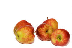 Cinq rouges, jaunes et vertes pommes Photos stock
