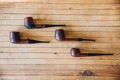 Cinq tuyaux de tabac Photographie stock libre de droits