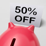 Cinqüênta por cento fora do mealheiro mostram uma promoção de 50 Metade-preços Imagem de Stock Royalty Free