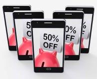 Cinqüênta por cento fora do mealheiro mostram uma promoção de 50 Metade-preços Fotos de Stock Royalty Free