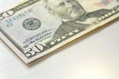 Cinquanta dollari con una nota 50 dollari Fotografie Stock Libere da Diritti