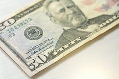 Cinquanta dollari con una nota 50 dollari Fotografie Stock