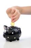 Cinquanta euro centesimi coniano dentro alla banca piggy immagini stock