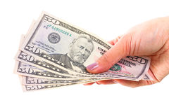 Cinquante billets de banque du dollar dans la main femelle photo libre de droits