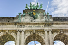 Cinquantenaire Park in Brussels. Triumphal arch Arc de Triomphe in Cinquantenaire park in Brussels, was planned for National Exhibition of 1880 to commemorate Royalty Free Stock Images