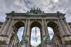 Cinquantenaire Park in Brussels. Triumphal arch Arc de Triomphe in Cinquantenaire park in Brussels, was planned for National Exhibition of 1880 to commemorate Stock Photo