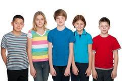 Cinque bambini felici Immagine Stock