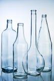 Cinque bottiglie di vetro vuote Fotografie Stock