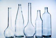 Cinque bottiglie di vetro vuote Fotografia Stock Libera da Diritti