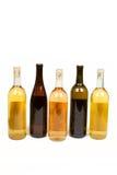 Cinque bottiglie variopinte di vino Fotografia Stock