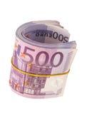 Cinque centesime banconote sotto l'elastico immagini stock