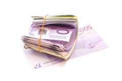 Cinque centesime banconote sotto l'elastico immagini stock libere da diritti