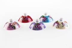 Cinque coperchi della tazza di tè della porcellana immagine stock