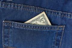 Cinque dollari in casella dei jeans Fotografia Stock Libera da Diritti