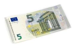 Cinque euro su un fondo bianco Immagine Stock