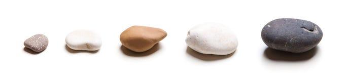 Cinque pietre in una riga Fotografie Stock