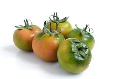 Cinque pomodori verdi Fotografie Stock Libere da Diritti