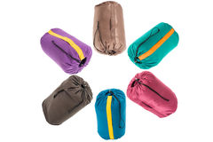 Cinque sacchi a pelo isolati su un fondo bianco Fotografia Stock Libera da Diritti