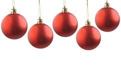 Cinque sfere di colore rosso di natale. Fotografia Stock Libera da Diritti