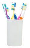 Cinque spazzolini da denti e spazzola interdental Fotografia Stock