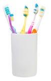 Cinque spazzolini da denti in vetro ceramico Fotografie Stock