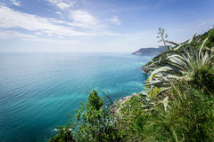 Cinque Terre coast overlooks aqua blue water of the ocean. Royalty Free Stock Image