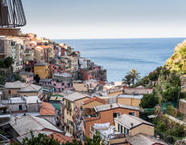 Cinque Terre. Colorful houses rest on the seaside cliffs in Cinque Terre, a unesco world heritage site Stock Photos