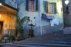 Typically Mediterranean brightly colored terrace styled homes wi. CINQUE TERRE, ITALY - APRIL 25 2018; Typically Mediterranean brightly colored terrace styled royalty free stock photos