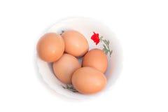 Cinque uova in tazza Immagine Stock
