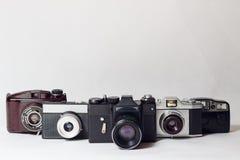 Cinque vecchie macchine fotografiche Fotografia Stock Libera da Diritti
